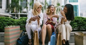 Women laughing and shopping