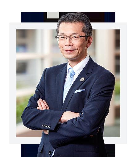 Headshot of Eiichi Shiokawa