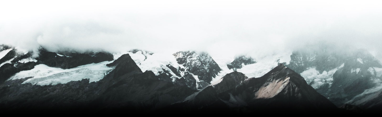 Cloud Topped Snowy Mountains